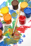 Paints and a brush Royalty Free Stock Images