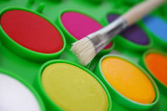 Paints and a brush. Watercolors and brush Royalty Free Stock Photography