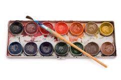 Paints with brush. Watercolor paint with brush isolated on white Stock Images