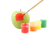Paints, brush and apple isolated Royalty Free Stock Image