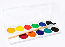 Paints and brush on a white Royalty Free Stock Image