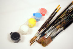 Paints and brushes Stock Photos