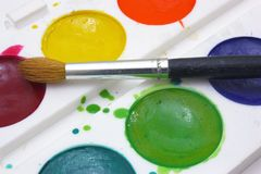 Paints with brushes Royalty Free Stock Photography