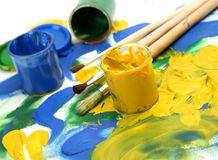 Paints and brushes. On a white background royalty free stock photo