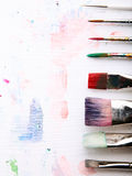 Paints and brushes. Creative workplace. Wood table stock photo
