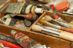 Paints and brushes art supplies in painting studio Stock Photo