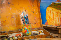 Paints and brushes art supplies in painting studio Royalty Free Stock Image