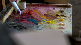 Paints and brushes Brushes and paints of the artist stock footage