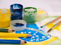 Paints,brushes and color pencils on the brazil flag watercolor p Stock Photo
