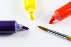 Paints and brushes color water Royalty Free Stock Images