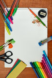 Paints, brushes, colored pencils and album. Drawing tools on a desk Royalty Free Stock Photos