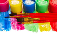 Paints and brushes. Colorful set of paints and brushes border isolated on white background stock image