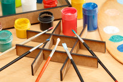 Paints and brushes on the desk ready for painting Royalty Free Stock Images