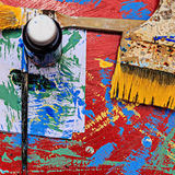 Paints and brushes on dirty background Royalty Free Stock Photography