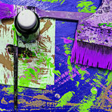Paints and brushes on dirty background Stock Photos