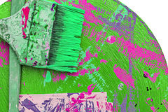 Paints and brushes on dirty background Royalty Free Stock Photos