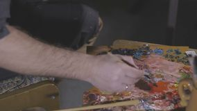 Paints and brushes on the easel.  stock footage