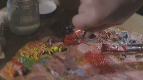 Paints and brushes on the easel.  stock video footage