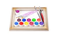 Paints and brushes in the frame of Stock Photos