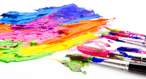 Paints and brushes isolated on a white Royalty Free Stock Photo