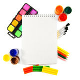 Paints ,brushes and notebook. Royalty Free Stock Photo