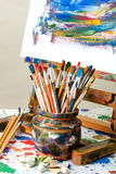 Paints and brushes. Oil paints and paint brushes on a palette Stock Photo