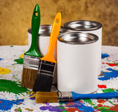 Paints and brushes. Pencils and ink drawing, spread out in a composition on the table Royalty Free Stock Photography