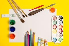 Paints brushes pencils. Paper colors mock up stock images