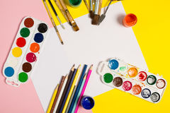 Paints brushes pencils. Paper colors mock up Royalty Free Stock Photo