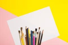 Paints brushes pencils stock photo