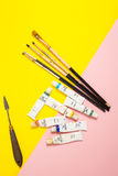 Paints brushes pencils stock photos