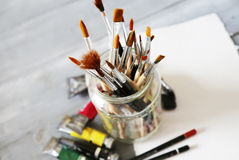 Paints and brushes Stock Images