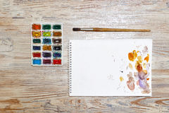 Paints, brushes and sketch pad. School drawing. Stock Photography
