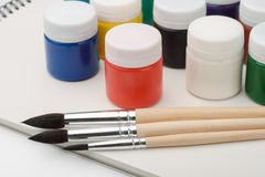 Paints, brushes and sketchbook Royalty Free Stock Photos