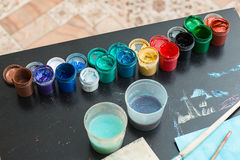 Paints and brushes are on the table Royalty Free Stock Photography