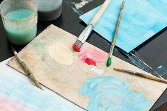Paints and brushes are on the table Stock Photo