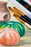 Paints with brushes on the watercolors painting. Stock Photo