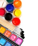 Paints and brushes on white background. Stock Photo