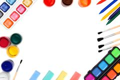 Paints and brushes on a white background. Stock Images