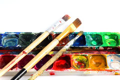 Paints and brushes on a white background Royalty Free Stock Photos