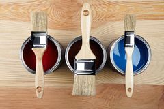 Paints and brushes on wooden background. Top view Stock Images