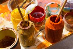 Paints and brushes in the workplace. royalty free stock photo