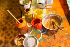 Paints and brushes in the workplace stock photography