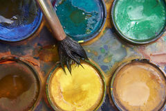 Paints and childish painting equipment, Watercolors and brushes, water color paints. Paints and childish painting equipment, Watercolors and brushes, Colorful Stock Photography