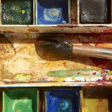 Paints and childish painting equipment, Watercolors and brushes, water color paints. Paints and childish painting equipment, Watercolors and brushes, Colorful Royalty Free Stock Images