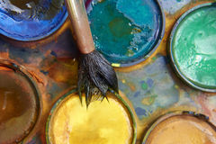 Paints and childish painting equipment, Watercolors and brushes, water color paints. Paints and childish painting equipment, Watercolors and brushes, Colorful Royalty Free Stock Image