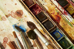 Paints and childish painting equipment, Watercolors and brushes, water color paints Royalty Free Stock Photos