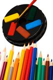 Paints and color pencils Stock Photography