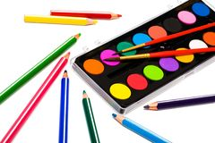 Paints and color pencils Royalty Free Stock Image