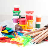 Paints, crayons, colored pencils, children's scissors. Creative Art Background made of paint, brushes, colored pencils and other tools for drawing on white Stock Image